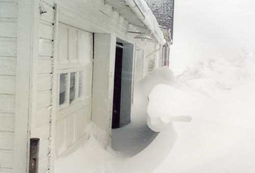 snowdrifts in front of the garage